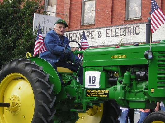 man on tractor in parade
