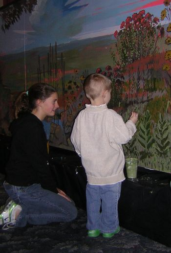 child painting on mural